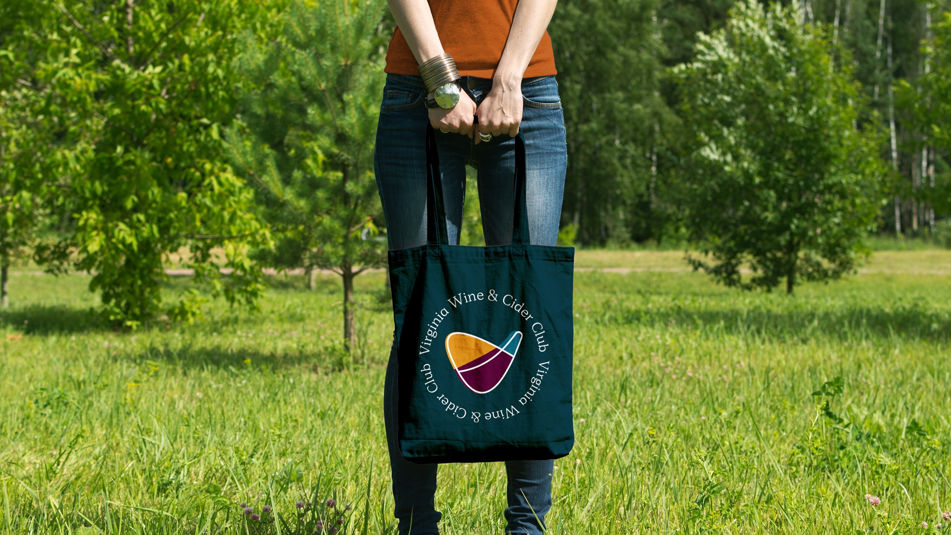 Woman holding VA Wine Club branded bag